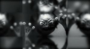 creepy seamonkey - I kind of mirrored this so that it's easier to get the center in frame for setting the wallpaper on a tablet.  It looks like he's trying to get out from behind the LCD on your device.